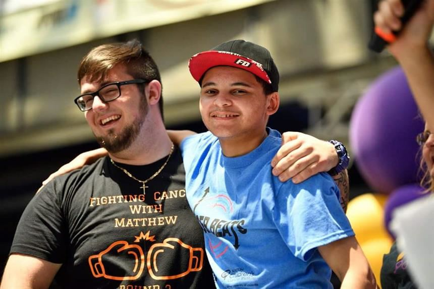 Billy Santoro and Matthew Walker upon seeing each other; photo courtesy of Mr. Dion Walker