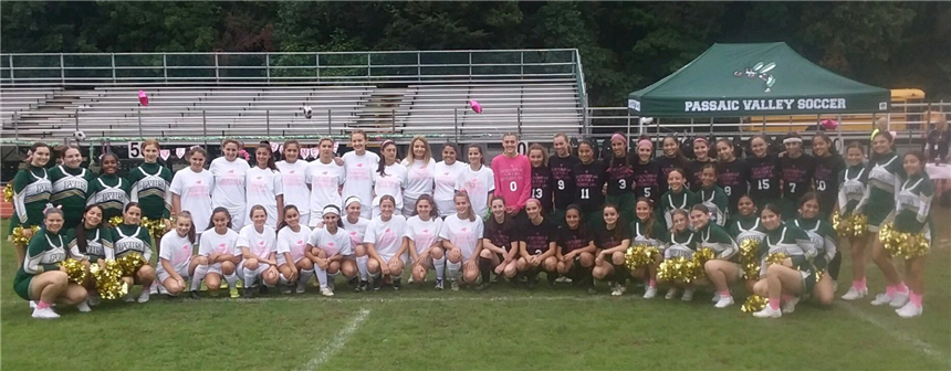 Girls Soccer team celebrating a victory after the breast cancer awareness game photo credit: Kathleen Berthold