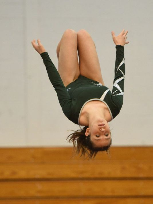 Patricia Giuriceo '20 flipping at meet; photo credit: Viorel Florescu