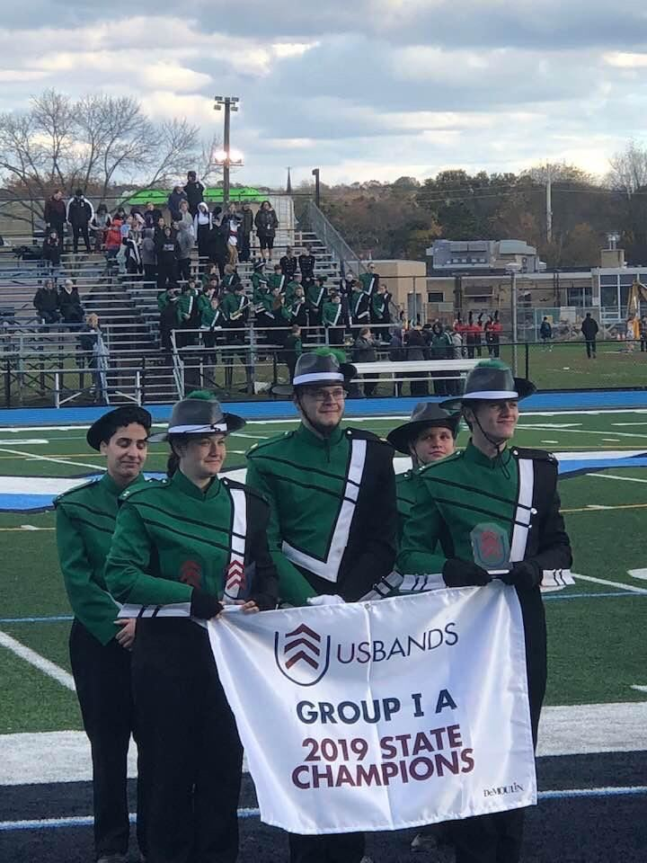 Marching Band displaying their accomplishments in front of their home crowd; photo credit: Mr. DeLuccia