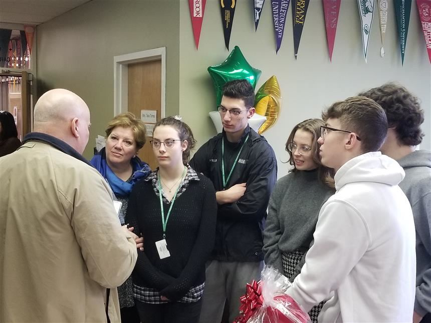 The Povolo siblings and Mrs. Polovo talking to the press; photo credit: Mr. Van Ess
