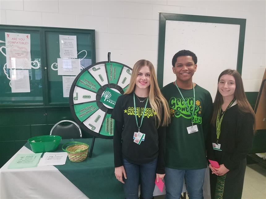 Mentors Gather Around Prize Wheel; Property of Ms. Kelly Morris