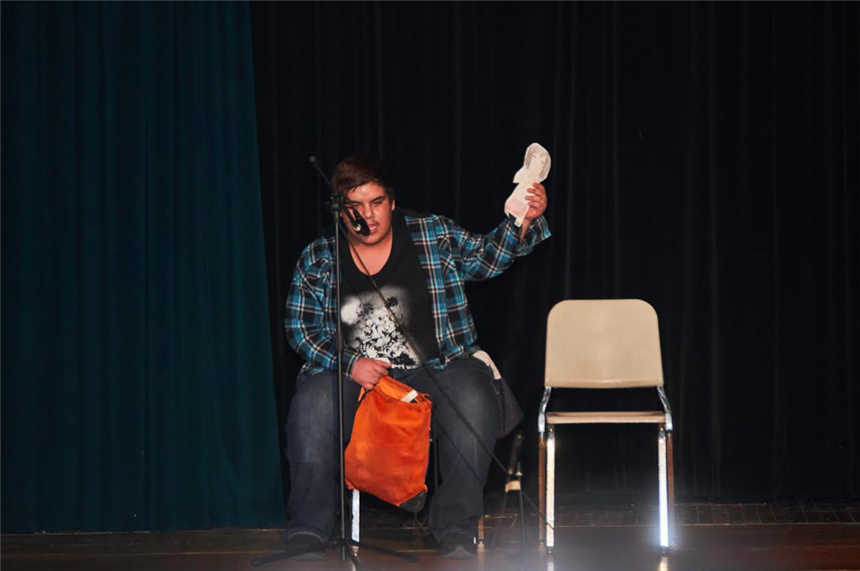 Jordan Garcia doing his stand-up comedy routine; photo credit: Yearbook Staff