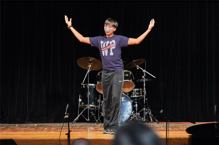Him Halim'21 on stage; photo credit: Yearbook Staff