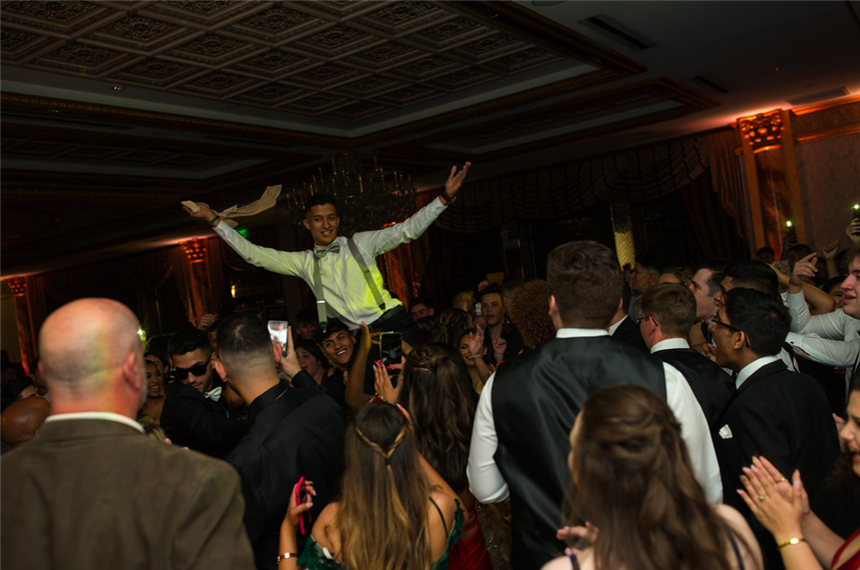 Lorans Washah'19 and crowd enjoying prom; photo credit: Mr. Alfred Cappello