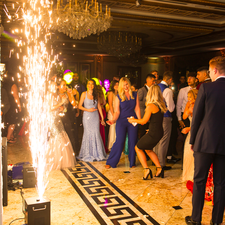 Seniors enjoying prom featuring the indoor fireworks; photo credit: Mr. Alfred Cappello