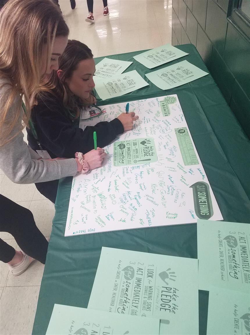 Students Sign the 'Say Something' Pledge; Property of Ms. Kelly Morris