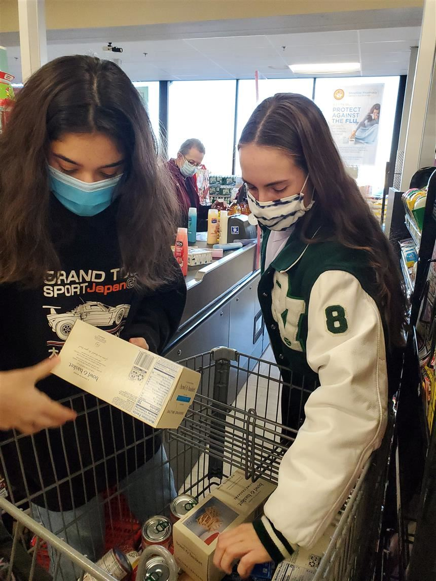 Betul Koc (left) and Devyn DiPasquale (right) shopping for the Food Pantry; photo credit: Ms. Grande