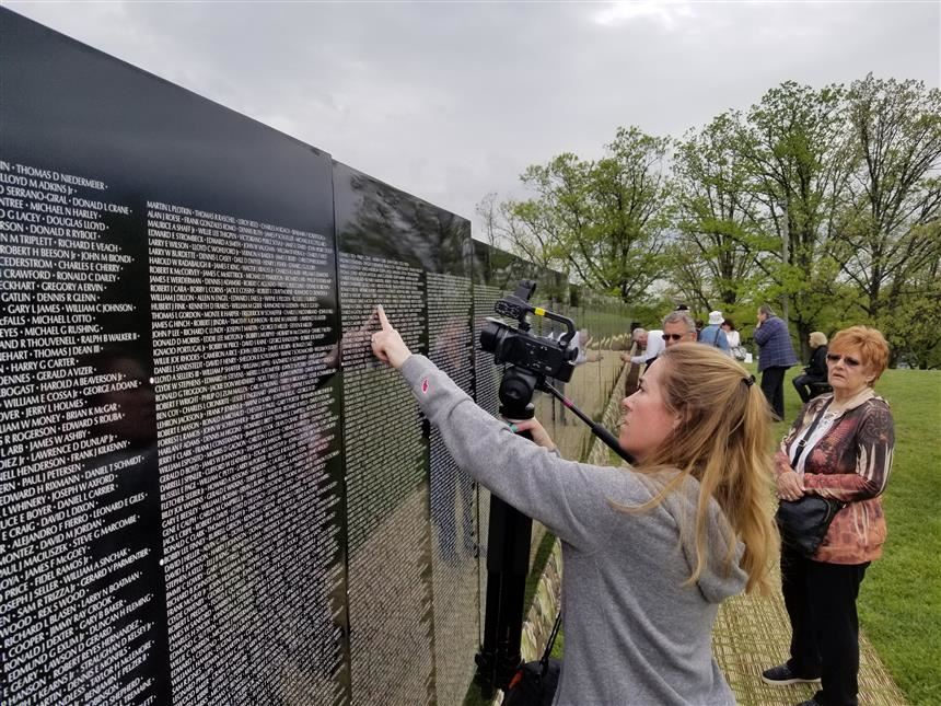 Ms. Roberts finding PV alumni Anthony Borregio's name on Vietnam Moving Wall Memorial; photo credit: Cornelius Van Ess