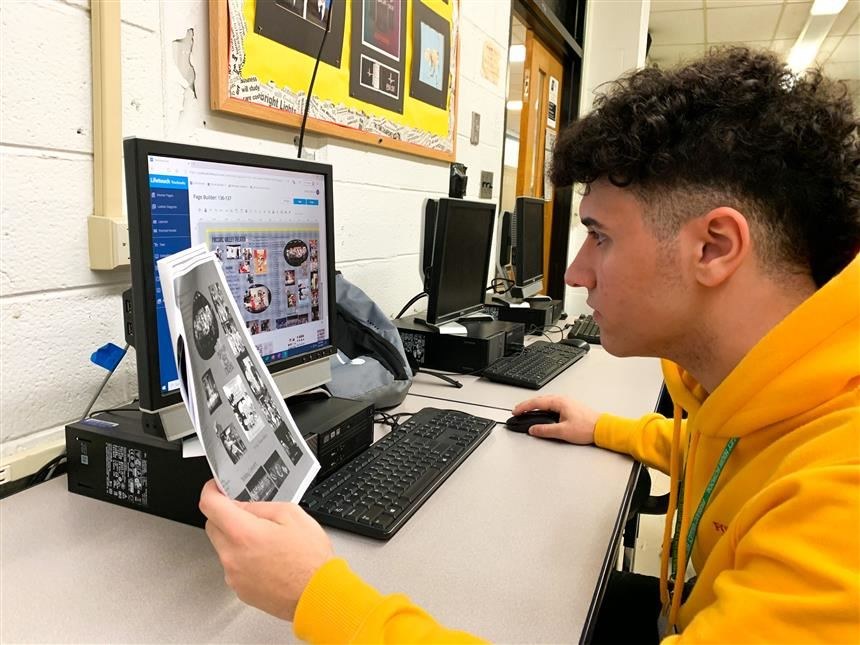 Yearbook staff working on layout; photo credit: Gabriella Cordova