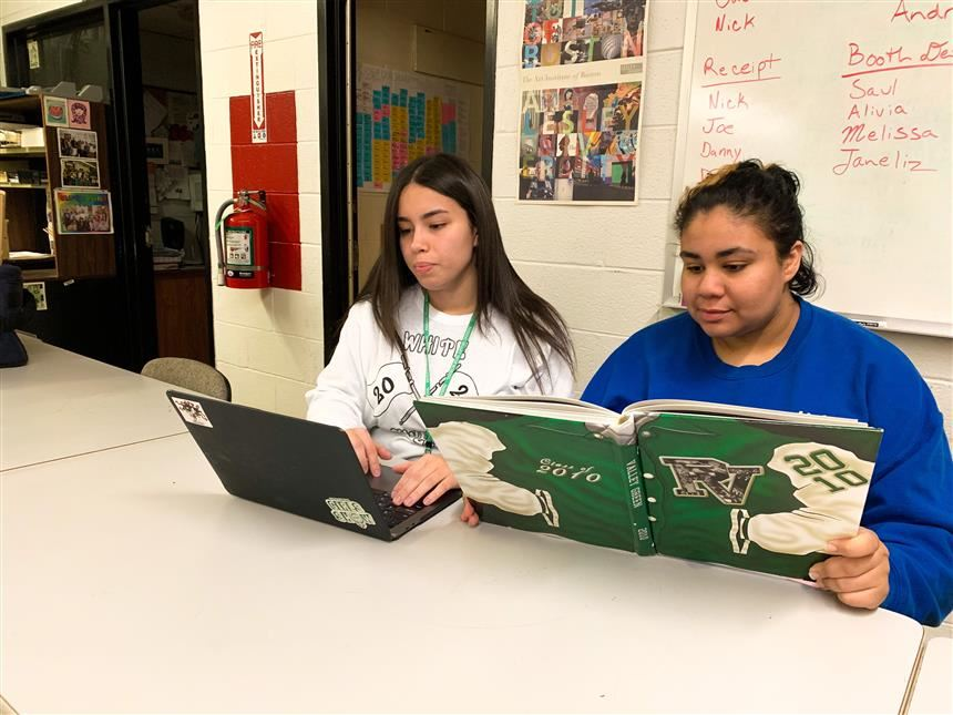 Yearbook staff reviewing past yearbooks; photo credit: Gabriella Cordova