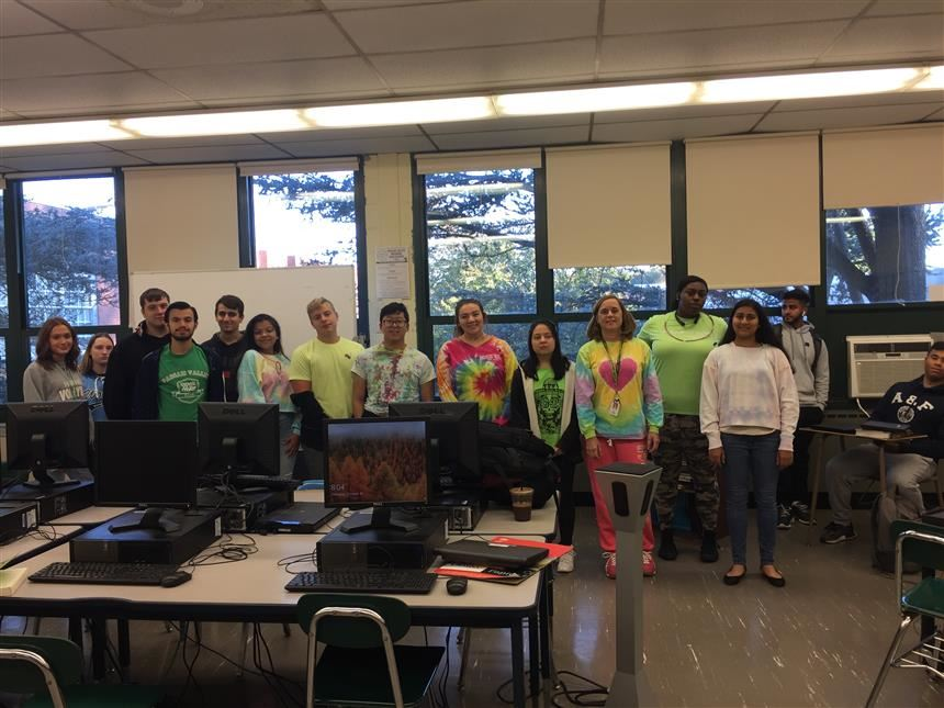 Ms. Odgers' Homeroom wearing their tie dye/neon shirts; photo credit: Jennan Alkhalaf '19
