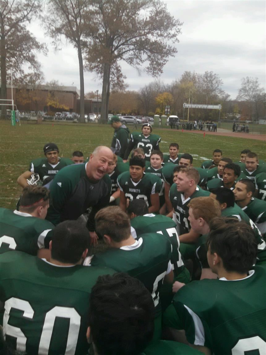 Coach Parlavecchio inspiring his team; property of Joe Benvenuti