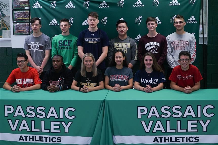 Athletic Signing Day group photo; photo credit: Kevin Ratta