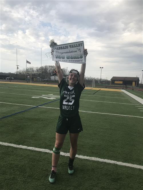 Cat Bennett honored for her 100th goal; photo credit: Ms. Demsey