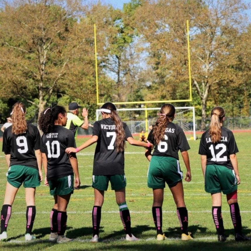 Girls' Soccer Shows Their Support with Annual Breast Cancer Awareness Game