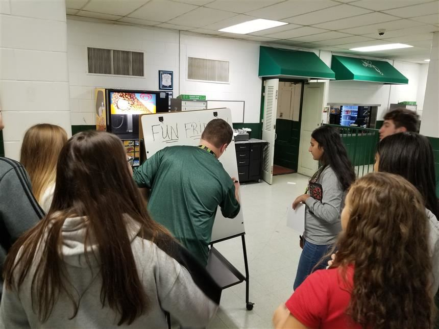 Students viewing the riddle being put up; photo credit: Mr. Cornelius Van Ess