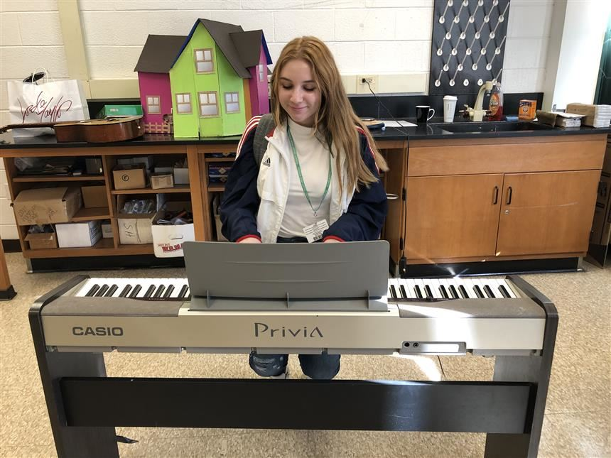 Student Playing Keyboard; photo credit: Kayla Leonard '20