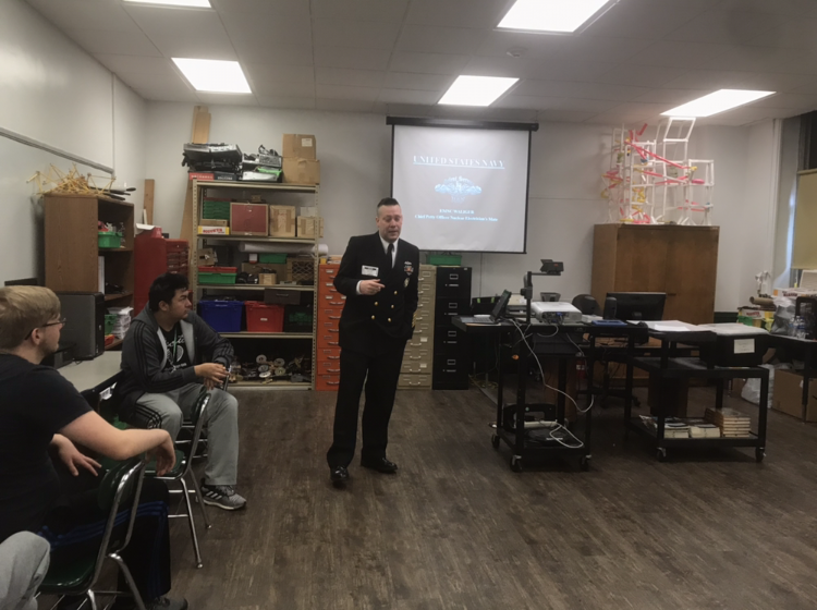 U.S. Navy Member Presents to the Class; Property of Mr. William Phillian
