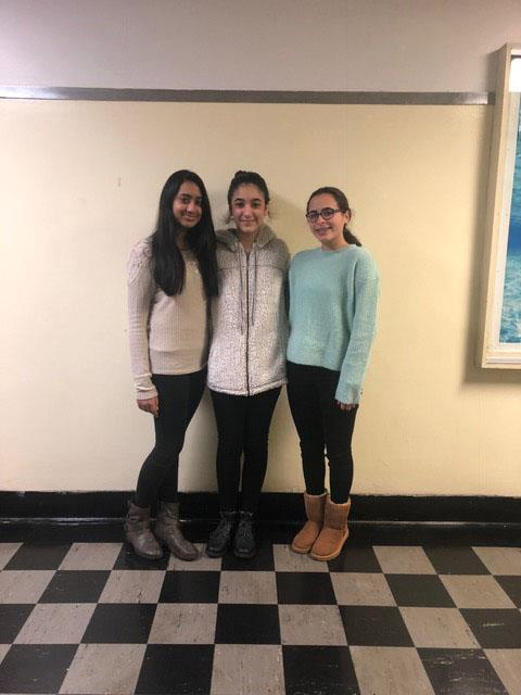 Raima, Betul, and Elizbeth standing together in the hall at PV. photo credit: Isabella Nicosia