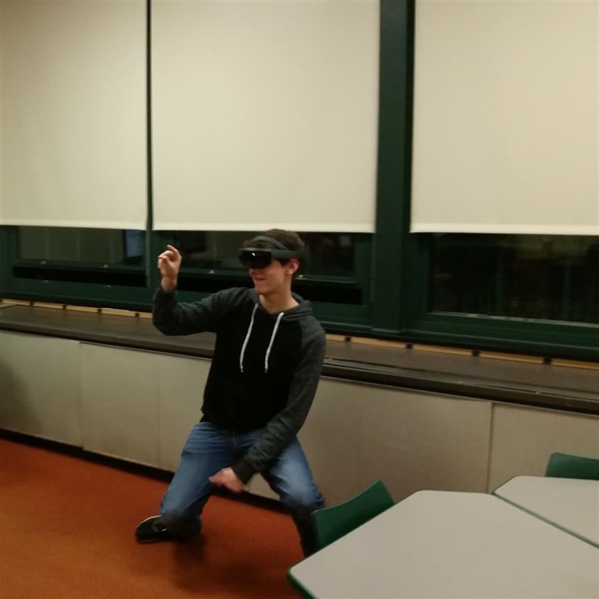 Zach Bleeker using Virtual Reality headset at 8th grade Oreintation