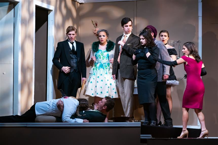 Clue cast after they discover the murder of the Chef; photo credit: Chris Krusberg
