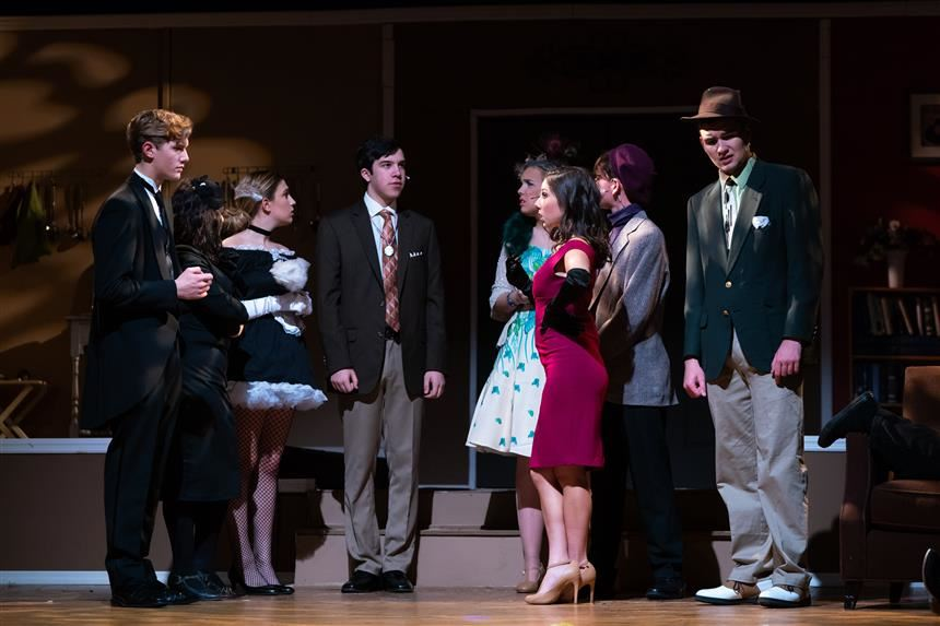 Clue cast figuring out why they were invited to dinner; photo credit:  Chris Krusberg