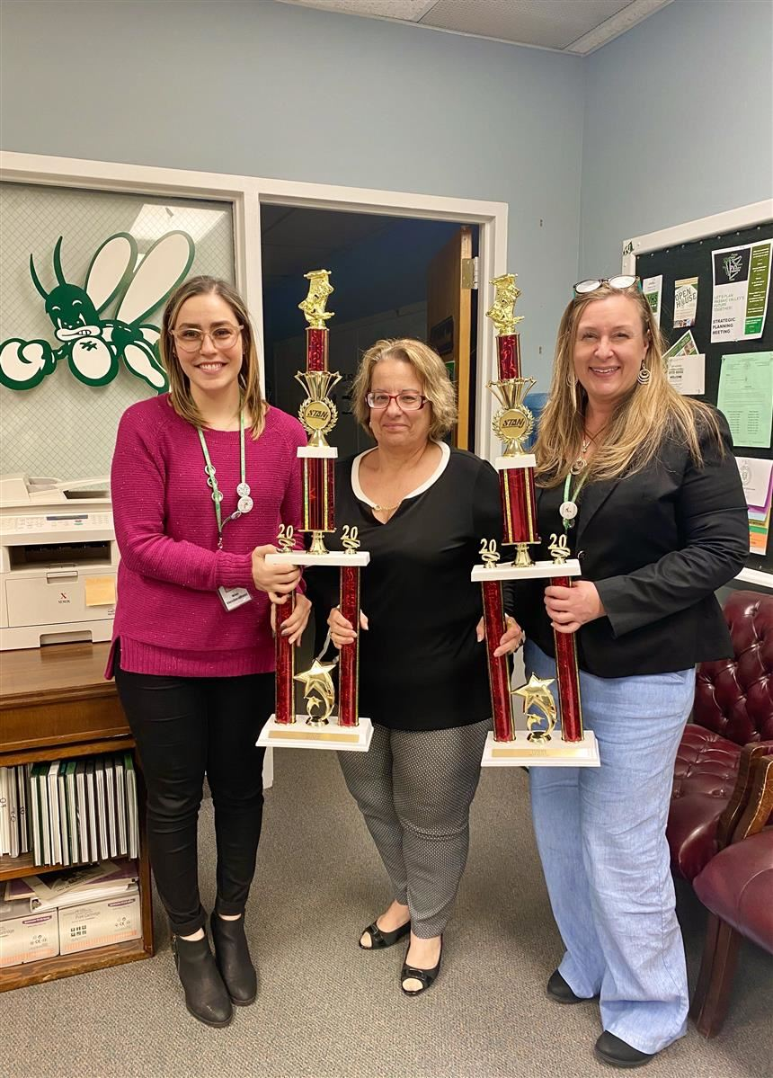 Ms. Vanderstreet, Dr. Cardillo, and Ms. Shue with STANJ trophies; property of Ms. Shue