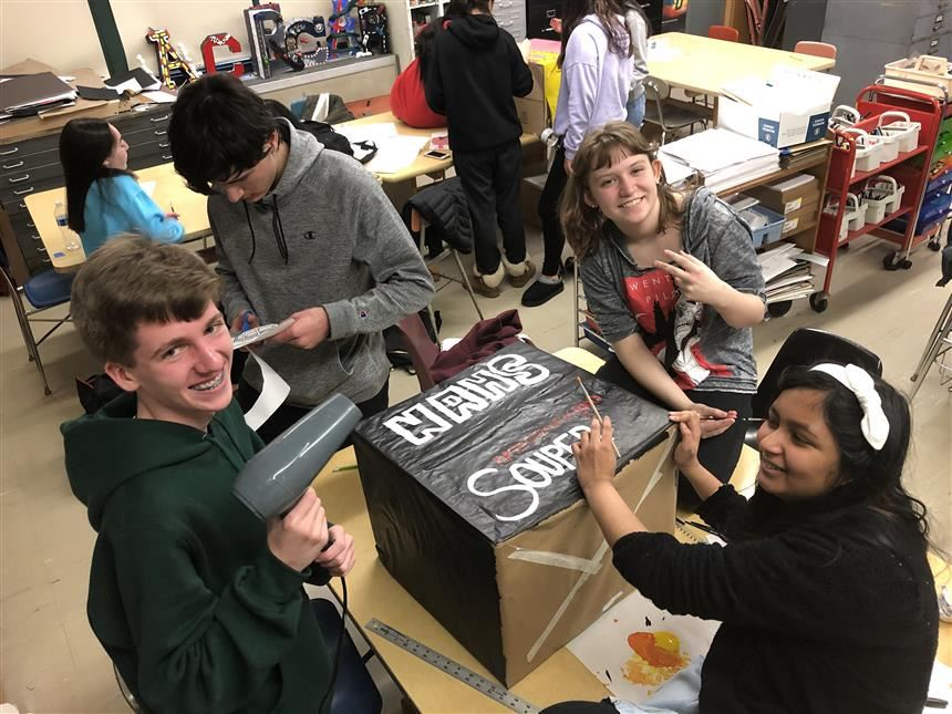 Students creating donation boxes; photo credit: Ms. Ingraham